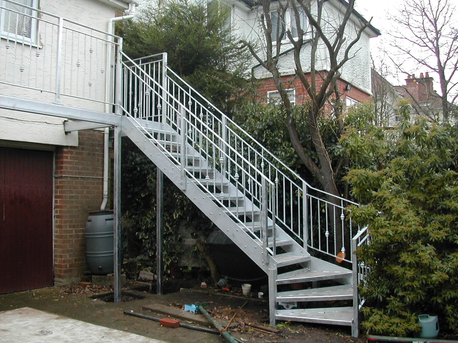 Galvanized Stairs Down from a Garden Balcony